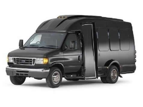 Side view of black mini coach vehicle